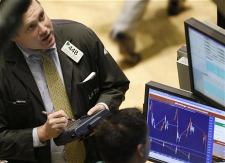 Trading specialists work on the floor of the New York Stock Exchange April 14, 2008. REUTERS/Chip East