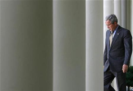 U.S. President George W. Bush walks through the colonnade to make a statement on ''No Child Left Behind'' reauthorization in the Rose Garden at the White House in Washington, October 9, 2007. REUTERS/Jim Young