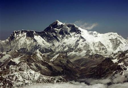 Mount Everest, the highest peak in the world, with an altitude of 8,848 metres (29,028 feet), is seen in this aerial view March 25, 2008. REUTERS/Desmond Boylan