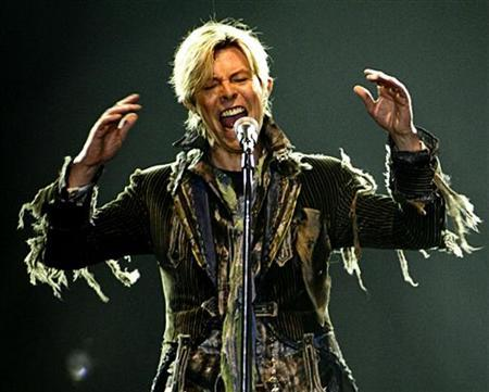 British singer David Bowie performs in a concert during his worldwide tour called ''A Reality Tour'' at T-mobile arena in Prague, June 23, 2004. REUTERS/David W Cerny DWC/WS