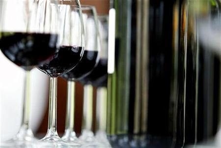 Glasses and bottles of Chateau Belcier red wine are seen in a testing room in Saint Emilion, southwestern France, November 6, 2007. REUTERS/Regis Duvignau