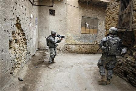 U.S. soldiers of Alpha Troop, 3-89 CAV patrol an alley in central Baghdad's Fadhil district April 16, 2008. REUTERS/Erik de Castro