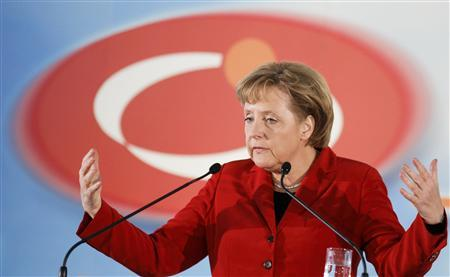 German Chancellor Angela Merkel talks to the guests after her visit of the factory 'Choren Industries' in Freiberg April 17, 2008. REUTERS/Johannes Eisele