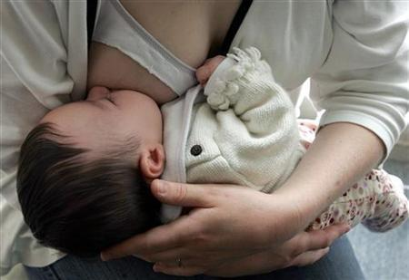 French woman breastfeeds her baby in Bordeaux, southwest France April 27, 2006. REUTERS/Regis Duvignau