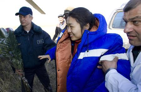 Ground crew help South Korea's first astronaut Yi So-Yeon after the Soyuz space capsule she was in landed in northern Kazakhstan April 19, 2008. A Russian space capsule landed about 420 kms (260 miles) off course in Kazakhstan on Saturday but the three-member crew was safe, an official at the mission control centre told Reuters. REUTERS/Shamil Zhumatov