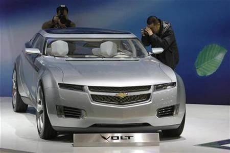 Visitors take pictures of Chevrolet Volt electric concept car at the Auto China 2008 show in Beijing April 20, 2008. General Motors Corp Chief Executive Rick Wagoner said on Sunday he was confident the automaker could resolve outstanding contract issues with local bargaining units for the United Auto Workers union that have shut down a plant producing popular crossover vehicles. REUTERS/Jason Lee
