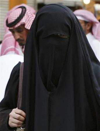 A veiled woman shops at al-Zall souk in downtown Riyadh November 16, 2007. REUTERS/Ali Jarekji