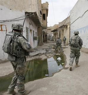 U.S. soldiers patrol central Baghdad's Fadhil neighbourhood April 16, 2008. REUTERS/Erik de Castro