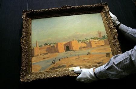 A Sotheby's employee holds Winston Churchill's ''Marrakech'' at Sotheby's auction house in central London December 11, 2007. REUTERS/Alessia Pierdomenico