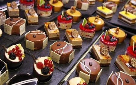 Miniature cakes are displayed at Alimentaria trade show in Barcelona in this March 13, 2008 file photo. REUTERS/Albert Gea