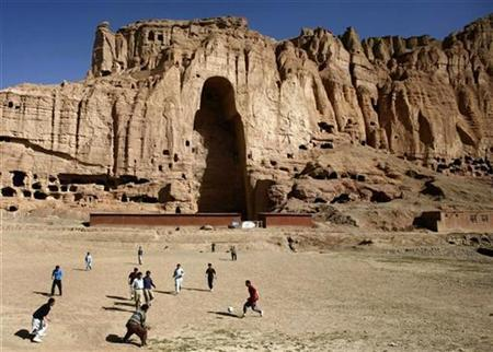 Afghan boys play soccer in front of the gaping niche where a giant Buddha statue used to stand in the central town of Bamiyan some 240 km (149 miles) northwest of Kabul April 13, 2007. REUTERS/Goran Tomasevic