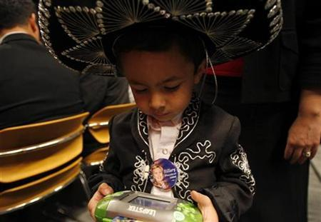 Four-year-old Marcos Mancera plays a video game in El Paso, Texas, February 12, 2008. REUTERS/Jessica Rinaldi