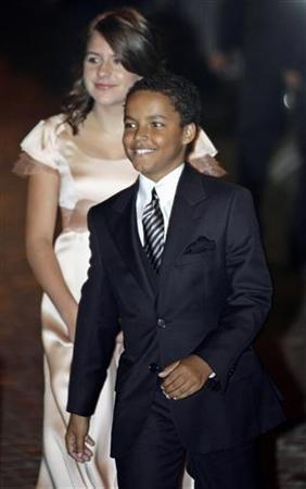 Actor Tom Cruise's children Isabella (L) and Connor arrive for a party at a restaurant in Rome November 16, 2006. Connor is set to follow in his father's footsteps, making his film debut in the upcoming Will Smith drama ''Seven Pounds,'' People magazine reported on Tuesday. REUTERS/Chris Helgren