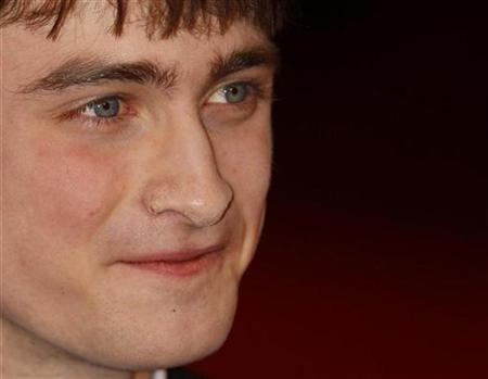 Actor Daniel Radcliffe arrives at the BAFTA awards ceremony at The Royal Opera House in London February 10, 2008. Radcliffe's search for a mystery Australian girl he met at an awards party has taken a twist worthy of his alter-ego Harry Potter. REUTERS/Stephen Hird