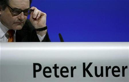 Swiss bank UBS general counsel Peter Kurer gestures during the general shareholder meeting of the bank in Basel April 23, 2008. REUTERS/Stefan Wermuth
