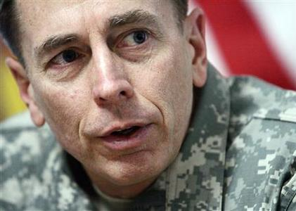 Army Gen. David Petraeus, commanding general of Multi-National Force-Iraq, answers a question during a meeting with members of the Department of Defense press pool travelling with Secretary of Defense Robert M. Gates in Baghdad, in this December 6, 2007 file picture. REUTERS/Haraz N. Ghanbari/Pool