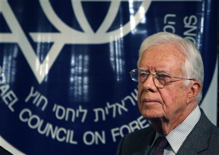 Former U.S. President Jimmy Carter pauses during a speech in Jerusalem April 21, 2008, after talks in Syria and Egypt with Hamas leaders. REUTERS/Ronen Zvulun