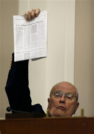 Congressman John Dingell (D-MI) holds up a newspaper story on the drug heparin as U.S. Food and Drug Administration (FDA) Commissioner Andrew von Eschenbach testifies before the House Energy and Commerce Oversight and Investigations Subcommitee on the FDA's foreign drug Inspection program on Capitol Hill in Washington April 22, 2008. REUTERS/Kevin Lamarque (