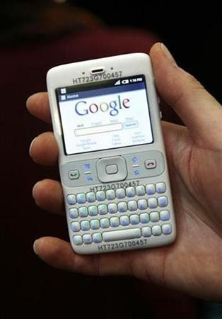 A hostess holds a prototype of the Google Android mobile by British chip designer ARM during the Mobile World Congress (formerly 3GSM World Congress) in Barcelona, February 11, 2008. REUTERS/Albert Gea