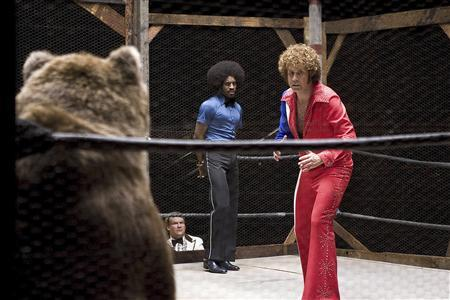 Actors Will Ferrell (R), Andy Richter (lower L) and Andre Benjamin (C) are shown in a scene of the 2008 film ''Semi-Pro'' in this undated publicity photograph. The grizzly bear featured in the scene has attacked and killed a handler at the Predators in Action wild animal training center near Big Bear, California for an unknown reason April 22, 2008. The five-year-old bear, known as Rocky, had been featured in several television commercials and films. REUTERS/Frank Masi/NEW LINE CINEMA/Handout