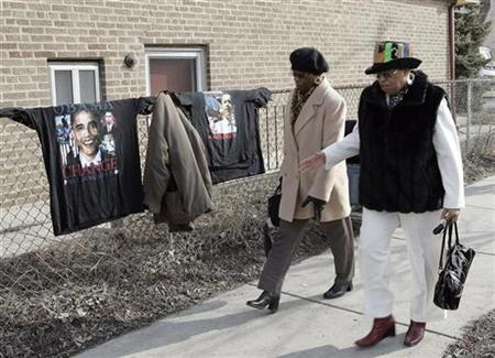 Parishioners walk past T-shirts for sale as they leave the Trinity United Church of Christ after Easter Sunday service in Chicago March 23, 2008. The church was formerly headed by pastor Jeremiah Wright. REUTERS/Frank Polich