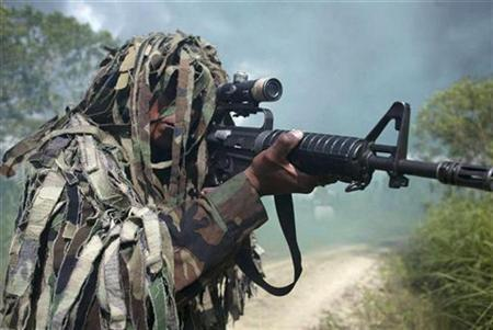 A Kaibil sniper is seen with full gear during an exhibition in the Special Forces Brigade, known as ''Kaibil's Hell'', in Poptun, Peten, October 30, 2006. A REUTERS/Carlos Duarte