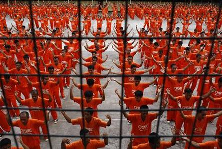 Prisoners dance during an exercise program at the Cebu Provincial Detention and Rehabilitation Center (CPDRC) in Cebu City, south of Manila, April 26, 2008. The prisoners' dancing exercises were made famous after a video of them was posted on the Internet last year. REUTERS/Darren Whiteside