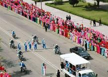 <p>La torcia Olimpica nelle strade di Pyongyang. REUTERS/Kyodo (NORTH KOREA)</p>
