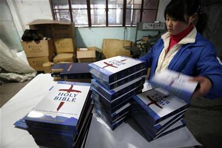 A worker packs new printed Bible books in a packing room at Amity Printing factory in Nanjing, Jiangsu province January 16, 2008. REUTERS/ Nir Elias
