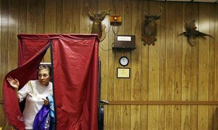 A woman leaves a voting booth for the Pennsylvania primaries at the Blue Mountain Fish & Game building in Danielsville, Pennsylvania, April 22, 2008. REUTERS/Shannon Stapleton