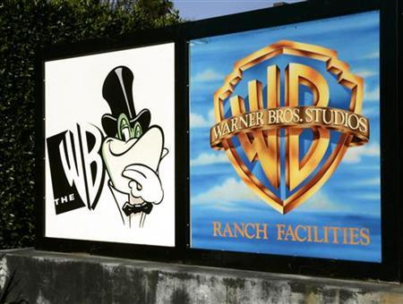 A sign for the WB television network (L) is shown at the network's offices on the Warner Bros. studios Ranch facilities lot in Burbank, California January 24, 2006. REUTERS/Fred Prouser