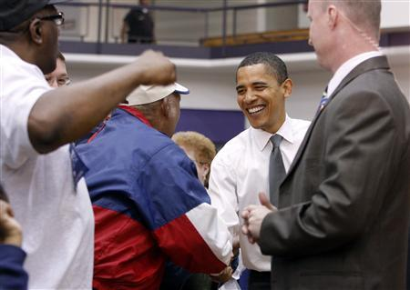 Democratic presidential candidate and Senator Barack Obama (D-IL) smiles as he greets supporters during a campaign stop in Marion, Indiana April 26, 2008. REUTERS/Frank Polich