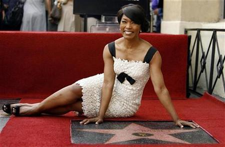 Actress Angela Bassett poses after being honored with a star on the Walk of Fame in Hollywood, California March 20, 2008. REUTERS/Mario Anzuoni