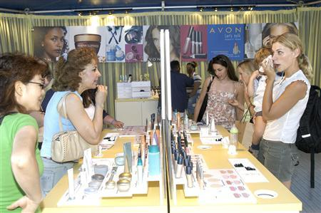 Women try Avon products in an undated handout photo. REUTERS/Feature Photo Service/Handout