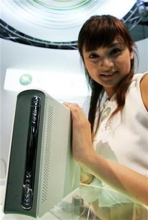 A model poses with Microsoft's Xbox 360 game console in a file photo. Microsoft said on Tuesday it is cutting prices on the Xbox 360 in four Asian regions by as much as 20 percent in an effort to expand the audience for the video game console. REUTERS/Kiyoshi Ota