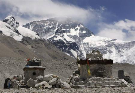 Memorials for those who have died trying to climb Mount Everest (top), also known as Qomolangma, can be seen at the base camp in the Tibet Autonomous Region April 30, 2008. REUTERS/David Gray