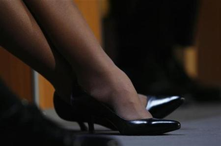 Picture shows the shoes of U.S. Secretary of State Condoleezza Rice as she crosses her legs following her key-note speech at the World Economic Forum (WEF) in the Swiss Alpine resort town of Davos January 23, 2008. REUTERS/Stefan Wermuth