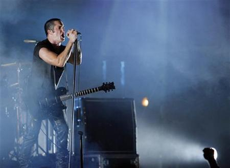 Trent Reznor of music group Nine Inch Nails performs at the Voodoo Music Experience concert held at Riverview Park in New Orleans, Louisiana October 29, 2005. REUTERS/Lucas Jackson