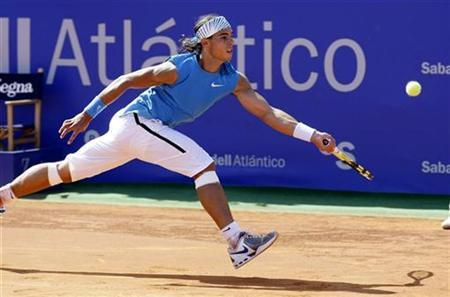 Rafael Nadal of Spain returns the ball to Potito Starace of Italy during their first round match in the Barcelona Open tennis tournament in Barcelona April 30, 2008. REUTERS/Gustau Nacarino