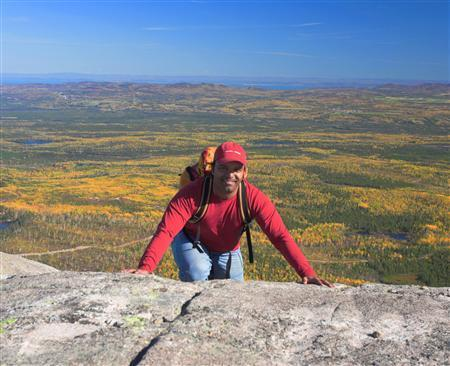 Ashutosh Rajekar poses for a photograph on the summit of Mont du Lac-des-Cygnes, at the edge of the Charlevoix meteorite crater, in Parc national des Grands-Jardins, Quebec, 2007. REUTERS/Andre-John Mas/Handout