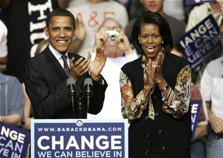 Democratic presidential candidate Senator Barack Obama and his wife Michelle applaud at his Pennsylvania primary election night rally in Evansville, Indiana, April 22, 2008. REUTERS/Jeff Haynes