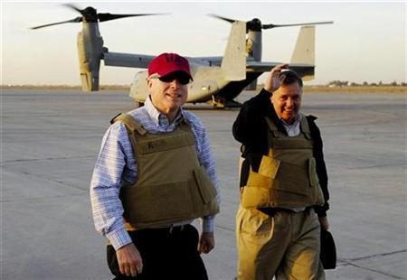 Republican presidential candidate Senator John McCain (R-AZ), left, and U.S. Senator Lindsey Graham (R-SC), right, make their way across the flight line after landing on a CV-22 Osprey at Sather Air Base in Baghdad, March 16, 2008. REUTERS/U.S. Air Force photo/Tech. Sgt. Jeffrey Allen/Handout
