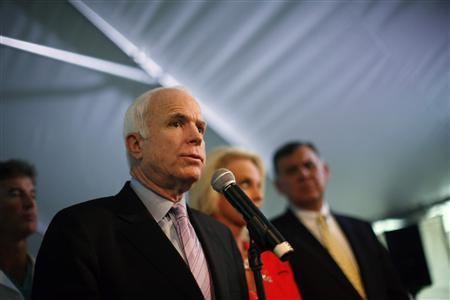 Republican US presidential candidate Senator John McCain listens speaks during a news conference at Miami's Children Hospital in Florida April 28, 2008. REUTERS/Carlos Barria
