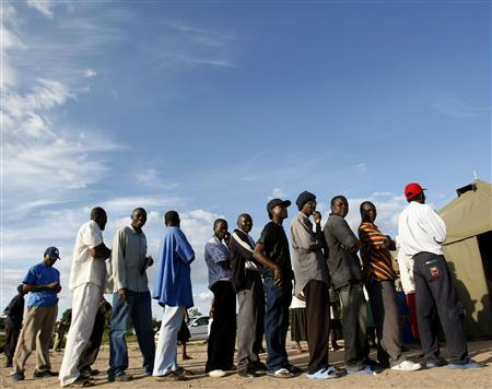 Zimbabweans line up to vote at a tented polling station in Chitungwiza, outside Harare, March 29, 2008. Zimbabwe's opposition Movement for Democratic Change said on Friday it would reject results of a presidential election that would force a run-off against veteran ruler Robert Mugabe. REUTERS/Mike Hutchings