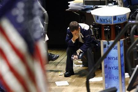 A trader puts his hand to his face while working on the floor of the New York Stock Exchange in New York November 1, 2007. REUTERS/Shannon Stapleton