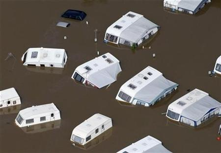 An aerial view shows a flooded caravan park in Tewkesbury, in central England July 22, 2007. REUTERS/Stephen Hird/Files