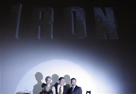 Actress Gwyneth Paltrow, director Jon Favreau (C) and actor Robert Downey Jr. pose on stage during the premiere of their film ''Iron Man'' in Berlin April 22, 2008. ''Iron Man,'' the latest Marvel comics title brought to the big screen, grossed an estimated $32.5 million from its first full day in North American theaters, independent box office analysts reported on Saturday. REUTERS/Johannes Eisele