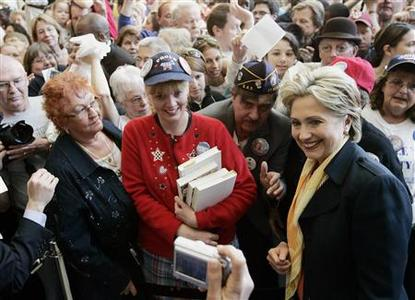 Democratic presidential candidate Senator Hillary Clinton (D-NY) poses for a photograph after meeting with supporters during a campaign stop at the Andorfer Commons at Indiana Tech in Fort Wayne, Indiana, May 4, 2008. REUTERS/Jeff Haynes