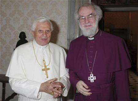 Pope Benedict XVI poses with the Archbishop of Canterbury Rowan Williams (R) during their meeting at the Vatican May 5, 2008. REUTERS/Osservatore Romano