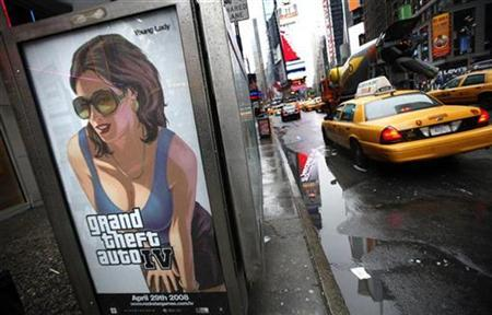 An advertisement for the ''Grand Theft Auto 4'' video game is seen on the side of a phone booth in New York's Times Square April 28, 2008. REUTERS/Mike Segar